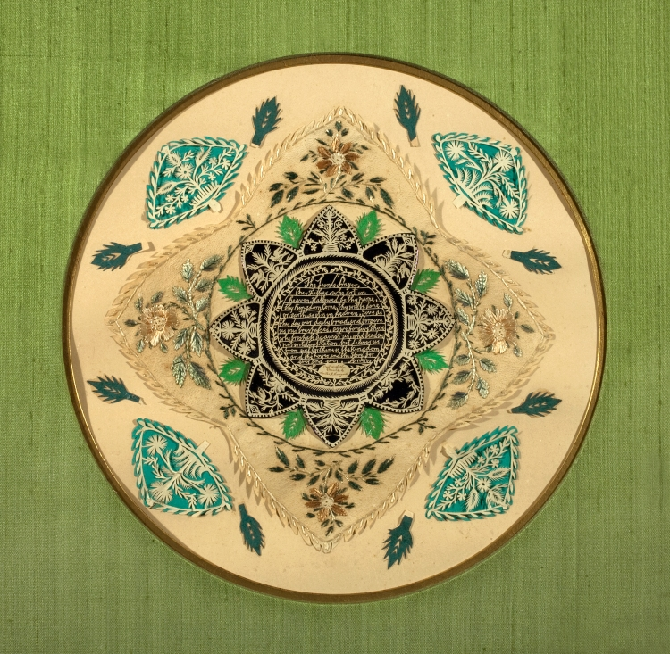 Lord's Prayer cut, gold paper, floral paper cut with intricate needle work surrounding.