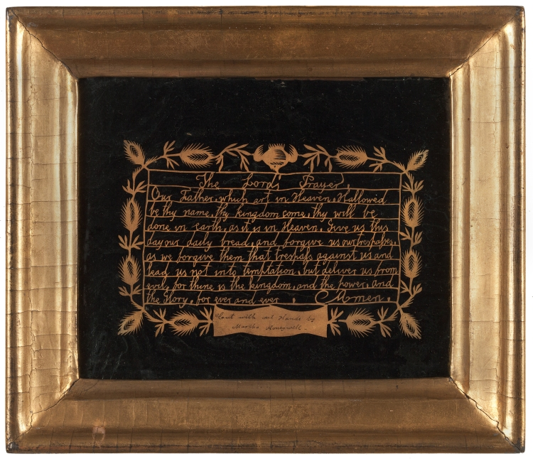 The Lord's Prayer, cut in beige paper with cut floral border, mounted on black paper with a gold frame.