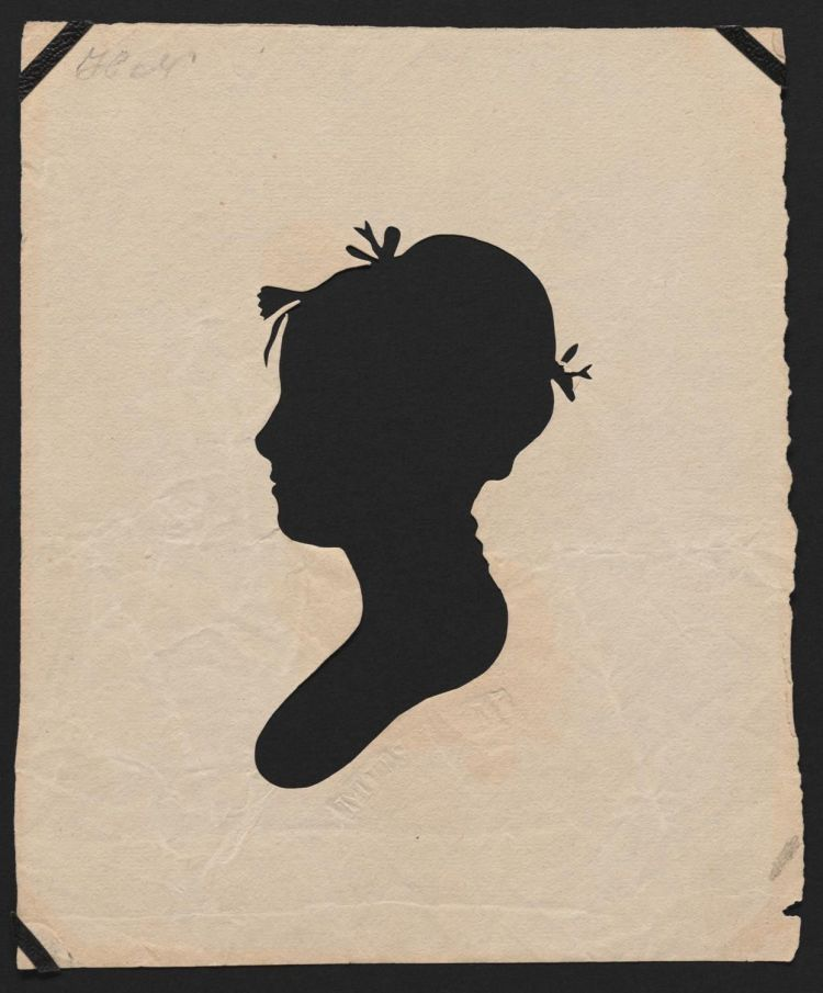 Silhouette portrait of of young woman with bows in hair.